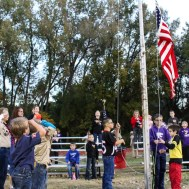 A local troop of Cub Scouts raise the American Flag during the National Anthem. The Hoisington Cardinals defeated the Ellsworth Bearcats 39 to 20 at Shanelac Field in Ellsworth, Kansas on October 14, 2016. (Photo: Joey Bahr, www.joeybahr.com)