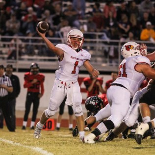 Hoisington Cardinal Tyler Specht (#1) throws a pass. The Hoisington Cardinals defeated the Ellsworth Bearcats 39 to 20 at Shanelac Field in Ellsworth, Kansas on October 14, 2016. (Photo: Joey Bahr, www.joeybahr.com)