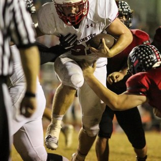 Ellsworth Bearcat Colby Kraus (#74) tries to grab Hoisington Cardinal Hunter Hanzlick (#27) out of the air. The Hoisington Cardinals defeated the Ellsworth Bearcats 39 to 20 at Shanelac Field in Ellsworth, Kansas on October 14, 2016. (Photo: Joey Bahr, www.joeybahr.com)