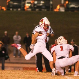 Hoisington Cardinal Inigo Barrena Carpio (#8) kicks a Point After Touchdown as Tyler Specht (#1) holds the ball. The Hoisington Cardinals defeated the Ellsworth Bearcats 39 to 20 at Shanelac Field in Ellsworth, Kansas on October 14, 2016. (Photo: Joey Bahr, www.joeybahr.com)