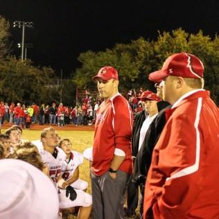 Hoisington Cardinal Head Coach Zach Baird addresses his players after the game. The Hoisington Cardinals defeated the Ellsworth Bearcats 39 to 20 at Shanelac Field in Ellsworth, Kansas on October 14, 2016. (Photo: Joey Bahr, www.joeybahr.com)