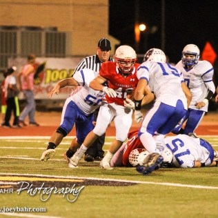 Lyons Lion Tyler Edwards (#15) tries to tackle Hoisington Cardinal Jake Curtis (#42). The Hoisington Cardinals defeated the Lyons Lions to win the KSHSAA Class 3A District 15 Championship at Elton Brown Field in Hoisington, Kansas on October 27, 2016. (Photo: Joey Bahr, www.joeybahr.com)