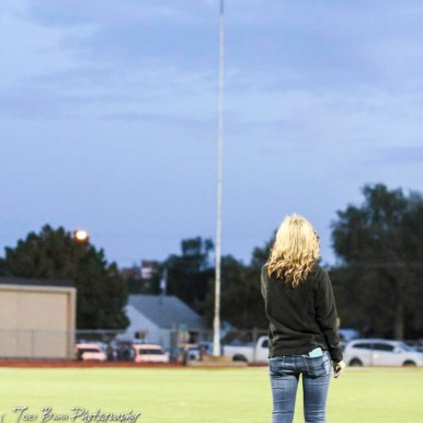 Allison Muth sings the National Anthem while facing the flag. The Great Bend Panthers defeated the Topeka West Chargers 70 to 31 in a KSHSAA Class 5A First Round matchup. at Memorial Stadium in Great Bend, Kansas on October 28, 2016. (Photo: Joey Bahr, www.joeybahr.com)