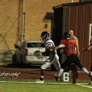 Topeka West Charger Chris Ellis (#13) scores a touchdown as Great Bend Panther Max Jerke (#6) pursues. The Great Bend Panthers defeated the Topeka West Chargers 70 to 31 in a KSHSAA Class 5A First Round matchup. at Memorial Stadium in Great Bend, Kansas on October 28, 2016. (Photo: Joey Bahr, www.joeybahr.com)