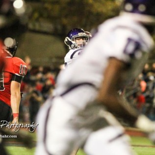Topeka West Charger Zach Shima (#10) looks down the field for an open receiver. The Great Bend Panthers defeated the Topeka West Chargers 70 to 31 in a KSHSAA Class 5A First Round matchup. at Memorial Stadium in Great Bend, Kansas on October 28, 2016. (Photo: Joey Bahr, www.joeybahr.com)