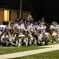 The Topeka West Chargers kneel as trainers look at /tw13. The Great Bend Panthers defeated the Topeka West Chargers 70 to 31 in a KSHSAA Class 5A First Round matchup. at Memorial Stadium in Great Bend, Kansas on October 28, 2016. (Photo: Joey Bahr, www.joeybahr.com)