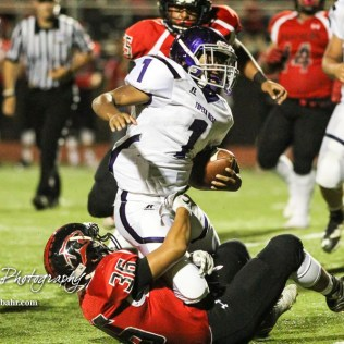 Great Bend Panther Braulio Vargas (#36) tackles Topeka West Charger Brian Wright (#1). The Great Bend Panthers defeated the Topeka West Chargers 70 to 31 in a KSHSAA Class 5A First Round matchup. at Memorial Stadium in Great Bend, Kansas on October 28, 2016. (Photo: Joey Bahr, www.joeybahr.com)