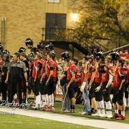 The Great Bend Panther sideline hold up their helmets as the ball is kicked off. The Great Bend Panthers defeated the Topeka West Chargers 70 to 31 in a KSHSAA Class 5A First Round matchup. at Memorial Stadium in Great Bend, Kansas on October 28, 2016. (Photo: Joey Bahr, www.joeybahr.com)