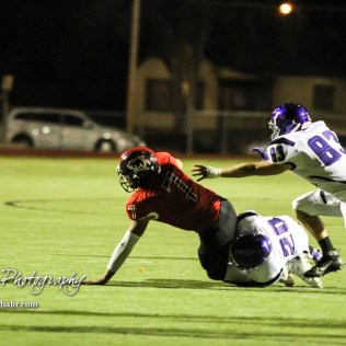 Topeka West Charger Willie Tucker (#20) sacks Great Bend Panther Jacob Murray (#7). The Great Bend Panthers defeated the Topeka West Chargers 70 to 31 in a KSHSAA Class 5A First Round matchup. at Memorial Stadium in Great Bend, Kansas on October 28, 2016. (Photo: Joey Bahr, www.joeybahr.com)