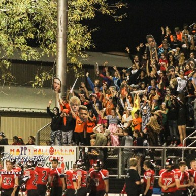 The Great Bend Student Section cheers a the Second Half starts. The Great Bend Panthers defeated the Topeka West Chargers 70 to 31 in a KSHSAA Class 5A First Round matchup. at Memorial Stadium in Great Bend, Kansas on October 28, 2016. (Photo: Joey Bahr, www.joeybahr.com)