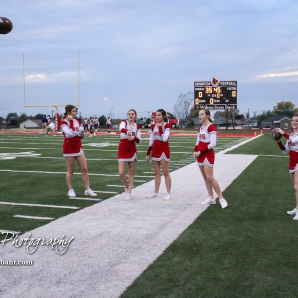 A group of Hoisington Cardinal Cheerleaders toss around a football before the game. The Hoisington Cardinals defeated the Lakin Broncs in the KSHSAA Class 3A Bi-District game with a score of 56 to 13 at Elton Brown Field in Hoisington, Kansas on November 1, 2016. (Photo: Joey Bahr, www.joeybahr.com)