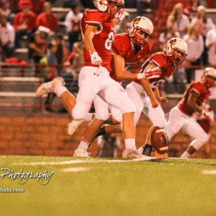 Hoisington Cardinal Brenner Donovan (#80) kicks off the ball. The Hoisington Cardinals defeated the Lakin Broncs in the KSHSAA Class 3A Bi-District game with a score of 56 to 13 at Elton Brown Field in Hoisington, Kansas on November 1, 2016. (Photo: Joey Bahr, www.joeybahr.com)