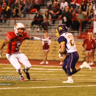 Hoisington Cardinal Cameron Davis (#5) breaks down to try and tackle Lakin Bronc Johnney Perez (#24). The Hoisington Cardinals defeated the Lakin Broncs in the KSHSAA Class 3A Bi-District game with a score of 56 to 13 at Elton Brown Field in Hoisington, Kansas on November 1, 2016. (Photo: Joey Bahr, www.joeybahr.com)