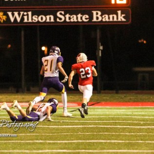 Hoisington Cardinal Sean Urban (#23) out runs Lakin Broncs Diego Davila (#21) and Dawsen Shalberg (#2) on an 85 yard kick off return for a touchdown. The Hoisington Cardinals defeated the Lakin Broncs in the KSHSAA Class 3A Bi-District game with a score of 56 to 13 at Elton Brown Field in Hoisington, Kansas on November 1, 2016. (Photo: Joey Bahr, www.joeybahr.com)