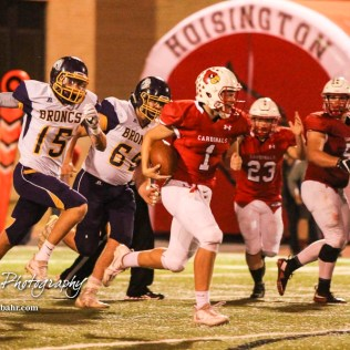 Hoisington Cardinal Tyler Specht (#1) takes off past Lakin Broncs Khai Hernandez (#15) and Logan Gugelmeyer (#69). The Hoisington Cardinals defeated the Lakin Broncs in the KSHSAA Class 3A Bi-District game with a score of 56 to 13 at Elton Brown Field in Hoisington, Kansas on November 1, 2016. (Photo: Joey Bahr, www.joeybahr.com)