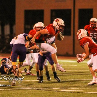Lakin Bronc Coy Adams (#4) tries to upend Hoisington Cardinal Hunter Hanzlick (#27). The Hoisington Cardinals defeated the Lakin Broncs in the KSHSAA Class 3A Bi-District game with a score of 56 to 13 at Elton Brown Field in Hoisington, Kansas on November 1, 2016. (Photo: Joey Bahr, www.joeybahr.com)