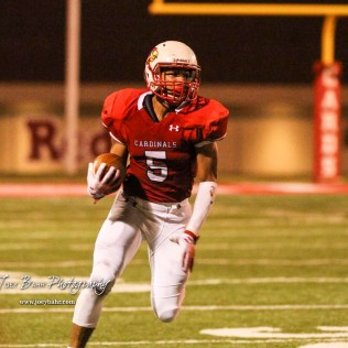 Hoisington Cardinal Cameron Davis (#5) runs around the corner. The Hoisington Cardinals defeated the Lakin Broncs in the KSHSAA Class 3A Bi-District game with a score of 56 to 13 at Elton Brown Field in Hoisington, Kansas on November 1, 2016. (Photo: Joey Bahr, www.joeybahr.com)