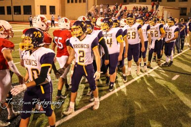 Members of the Hoisington Cardinals and Lakin Broncs shake hands following the game. The Hoisington Cardinals defeated the Lakin Broncs in the KSHSAA Class 3A Bi-District game with a score of 56 to 13 at Elton Brown Field in Hoisington, Kansas on November 1, 2016. (Photo: Joey Bahr, www.joeybahr.com)