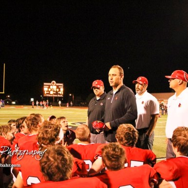 Hoisington Cardinal Head Coach Zach Baird addresses his players following the game. The Hoisington Cardinals defeated the Lakin Broncs in the KSHSAA Class 3A Bi-District game with a score of 56 to 13 at Elton Brown Field in Hoisington, Kansas on November 1, 2016. (Photo: Joey Bahr, www.joeybahr.com)