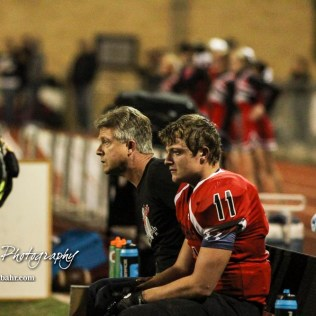 First Congressional District Candidate Dr. Roger Marshall sits next to his son Great Bend Panther Cal Marshall (#11) after he was evaluated for a concussion. The Great Bend Panthers defeated the Andover Trojans in the KSHSAA Class 5A Regional playoff game with a score of 16 to 7 at Memorial Stadium in Great Bend, Kansas on November 4, 2016. (Photo: Joey Bahr, www.joeybahr.com)