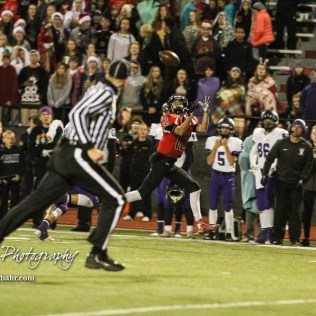 Great Bend Panther Koy Brack (#12) stretches out his arms to catch a pass thrown to him. The Great Bend Panthers defeated the Valley Center Hornets to win the KSHSAA Class 5A Sectional by a score of 28 to 24 at Memorial Field in Great Bend, Kansas on November 11, 2016. (Photo: Joey Bahr, www.joeybahr.com)
