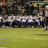 The Valley Center Hornets gather in prayer as trainers tend to their teammate, Don Boone (#3). The Great Bend Panthers defeated the Valley Center Hornets to win the KSHSAA Class 5A Sectional by a score of 28 to 24 at Memorial Field in Great Bend, Kansas on November 11, 2016. (Photo: Joey Bahr, www.joeybahr.com)
