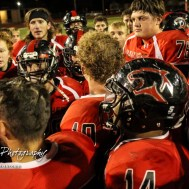 Great Bend Panther Jensen Randall (#10) addresses the players following the game. The Great Bend Panthers defeated the Valley Center Hornets to win the KSHSAA Class 5A Sectional by a score of 28 to 24 at Memorial Field in Great Bend, Kansas on November 11, 2016. (Photo: Joey Bahr, www.joeybahr.com)