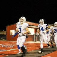 Goddard Lion Jordan Cooke (#3) leads his team onto the field. The Goddard Lions defeated the Great Bend Panthers to win the KSHSAA Class 5A Sub-State Championship by a score of 50 to 21 at Memorial Field in Great Bend, Kansas on November 18, 2016. (Photo: Joey Bahr, www.joeybahr.com)