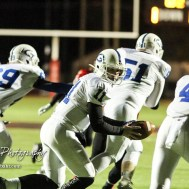 Goddard Lion Blake Sullivan (#11) spins to hand off the ball to Kody Gonzalez (#4). The Goddard Lions defeated the Great Bend Panthers to win the KSHSAA Class 5A Sub-State Championship by a score of 50 to 21 at Memorial Field in Great Bend, Kansas on November 18, 2016. (Photo: Joey Bahr, www.joeybahr.com)