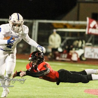 Great Bend Panther Max Jerke (#6) dives to try and tackle Goddard Lion Kody Gonzalez (#4). The Goddard Lions defeated the Great Bend Panthers to win the KSHSAA Class 5A Sub-State Championship by a score of 50 to 21 at Memorial Field in Great Bend, Kansas on November 18, 2016. (Photo: Joey Bahr, www.joeybahr.com)