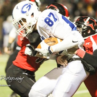 Great Bend Panther Jensen Randall (#10) tries to pull down Goddard Lion Bryant Mocaby (#87). The Goddard Lions defeated the Great Bend Panthers to win the KSHSAA Class 5A Sub-State Championship by a score of 50 to 21 at Memorial Field in Great Bend, Kansas on November 18, 2016. (Photo: Joey Bahr, www.joeybahr.com)
