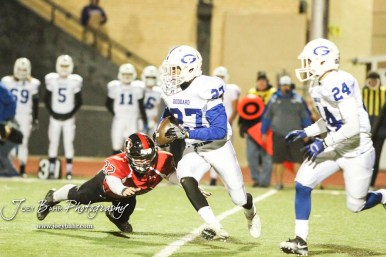 Great Bend Panther Payton Mauler (#32) reaches out to try and tackle Goddard Lion Myael Williams (#27). The Goddard Lions defeated the Great Bend Panthers to win the KSHSAA Class 5A Sub-State Championship by a score of 50 to 21 at Memorial Field in Great Bend, Kansas on November 18, 2016. (Photo: Joey Bahr, www.joeybahr.com)