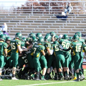 The Pratt Greenbacks huddle up during warmups. The Pratt Greenbacks defeated the Hayden Wildcats 48 to 14 to win the KSHSAA Class 4A Division II State Championship Game at Salina Stadium in Salina, Kansas on November 26, 2016. (Photo: Joey Bahr, www.joeybahr.com)