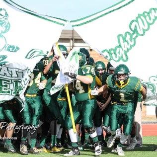 The Pratt Greenbacks take the field prior to the game. The Hayden Wildcats and the Pratt Greenbacks compete in the KSHSAA Class 4A Division II State Championship Game at Salina Stadium in Salina, Kansas on November 26, 2016. (Photo: Joey Bahr, www.joeybahr.com)