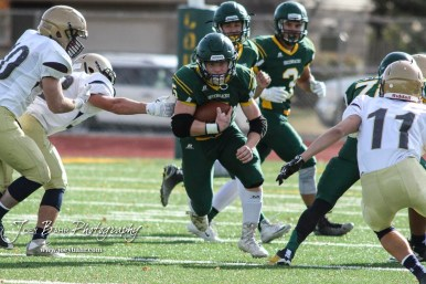 Pratt Greenback Travis Theis (#5) finds a hole to run through. The Pratt Greenbacks defeated the Hayden Wildcats 48 to 14 to win the KSHSAA Class 4A Division II State Championship Game at Salina Stadium in Salina, Kansas on November 26, 2016. (Photo: Joey Bahr, www.joeybahr.com)
