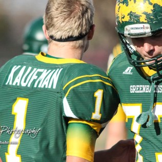 Pratt Greenback Justin Lamatsch (#73) consoles Hunter Kaufman (#1) after a game ending ankle injury. The Pratt Greenbacks defeated the Hayden Wildcats 48 to 14 to win the KSHSAA Class 4A Division II State Championship Game at Salina Stadium in Salina, Kansas on November 26, 2016. (Photo: Joey Bahr, www.joeybahr.com)