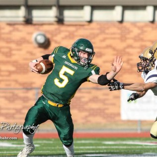 Pratt Greenback Travis Theis (#5) extends his arm for a stiff arm. The Pratt Greenbacks defeated the Hayden Wildcats 48 to 14 to win the KSHSAA Class 4A Division II State Championship Game at Salina Stadium in Salina, Kansas on November 26, 2016. (Photo: Joey Bahr, www.joeybahr.com)