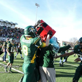 Pratt players douse Pratt Greenback Head Coach Jamie Cruce with water following the game. The Pratt Greenbacks defeated the Hayden Wildcats 48 to 14 to win the KSHSAA Class 4A Division II State Championship Game at Salina Stadium in Salina, Kansas on November 26, 2016. (Photo: Joey Bahr, www.joeybahr.com)