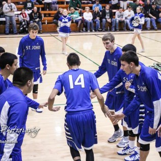 St. John Tiger #14 Alexis Valenzuela greets his teammates as his name is announced prior to the game. The St. John Tigers defeated the Central Plains Oilers by a score of 62 to 31 at Central Plains High School in Claflin, Kansas on December 13, 2016. (Photo: Joey Bahr, www.joeybahr.com)