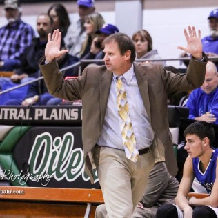 St. John Tiger Head Coach Clint Kinnamon calls a play. The St. John Tigers defeated the Central Plains Oilers by a score of 62 to 31 at Central Plains High School in Claflin, Kansas on December 13, 2016. (Photo: Joey Bahr, www.joeybahr.com)