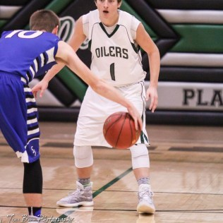 St. John Tiger #10 Cole Kinnamon watches Central Plains Oiler #1 Alex Hickel for an opening. The St. John Tigers defeated the Central Plains Oilers by a score of 62 to 31 at Central Plains High School in Claflin, Kansas on December 13, 2016. (Photo: Joey Bahr, www.joeybahr.com)