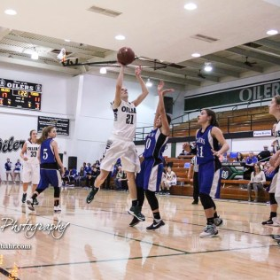 Central Plains Lady Oiler #21 Cassidy Crites pulls up for a shot over St. John Lady Tiger #10 Jackie Rios. The Central Plains Lady Oilers defeated the St. John Lady Tigers by a score of 87 to 41 at Central Plains High School in Claflin, Kansas on December 13, 2016. (Photo: Joey Bahr, www.joeybahr.com)