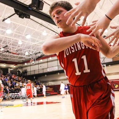 Hoisington Cardinal #11 Tyler Specht greets fans after being introduced prior to the start of the game. The Hoisington Cardinals defeated Otis-Bison Cougars 56 to 39 in the Boys Semi-Final of the 2017 Hoisington Winter Jam at Hoisington Activity Center in Hoisington, Kansas on January 20, 2017. (Photo: Joey Bahr, www.joeybahr.com)
