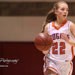Otis-Bison Lady Cougar #22 Maddie Wiltse brings the ball down the court. The Otis-Bison Lady Cougars defeated the LaCrosse Lady Leopards 61 to 55 in the Girls Semi-Final of the 2017 Hoisington Winter Jam at Hoisington Activity Center in Hoisington, Kansas on January 20, 2017. (Photo: Joey Bahr, www.joeybahr.com)
