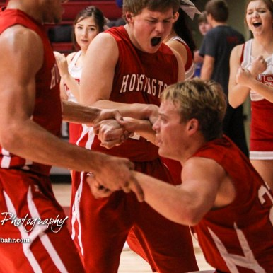 Hoisington Cardinals #11 Tyler Specht and #5 Cameron Davis pull up #22 Grant Dolechek off the floor after a hard foul. The Hoisington Cardinals defeated Otis-Bison Cougars 56 to 39 in the Boys Semi-Final of the 2017 Hoisington Winter Jam at Hoisington Activity Center in Hoisington, Kansas on January 20, 2017. (Photo: Joey Bahr, www.joeybahr.com)