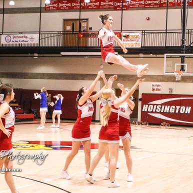 The Hoisington Cardinal Cheerleaders perform a stunt during a timeout. The Hoisington Cardinals defeated Otis-Bison Cougars 56 to 39 in the Boys Semi-Final of the 2017 Hoisington Winter Jam at Hoisington Activity Center in Hoisington, Kansas on January 20, 2017. (Photo: Joey Bahr, www.joeybahr.com)