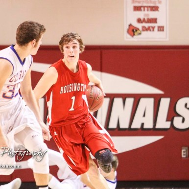 Hoisington Cardinal #1 Brenner Donovan brings the ball behind his back as he heads down the court. The Hoisington Cardinals defeated Otis-Bison Cougars 56 to 39 in the Boys Semi-Final of the 2017 Hoisington Winter Jam at Hoisington Activity Center in Hoisington, Kansas on January 20, 2017. (Photo: Joey Bahr, www.joeybahr.com)