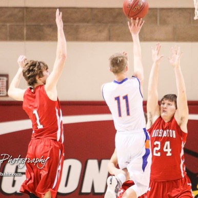 Hoisington Cardinal #24 Eric Barrett posts up as Otis-Bison Cougar #11 Trevor Trapp shoots over him. The Hoisington Cardinals defeated Otis-Bison Cougars 56 to 39 in the Boys Semi-Final of the 2017 Hoisington Winter Jam at Hoisington Activity Center in Hoisington, Kansas on January 20, 2017. (Photo: Joey Bahr, www.joeybahr.com)