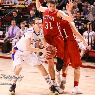 Otis-Bison Cougar #24 Tanner Loucks goes for a shot as Hoisington Cardinal #31 Kyle Lang tries to avoid him. The Hoisington Cardinals defeated Otis-Bison Cougars 56 to 39 in the Boys Semi-Final of the 2017 Hoisington Winter Jam at Hoisington Activity Center in Hoisington, Kansas on January 20, 2017. (Photo: Joey Bahr, www.joeybahr.com)