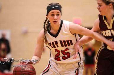 Great Bend Lady Panther #25 Carly Dreiling drives inside a Hays Lady Indian. The Great Bend Lady Panthers defeated the Hays Lady Indians by a score of 54 to 41 at Great Bend High School in Great Bend, Kansas on January 10, 2017. (Photo: Joey Bahr, www.joeybahr.com)